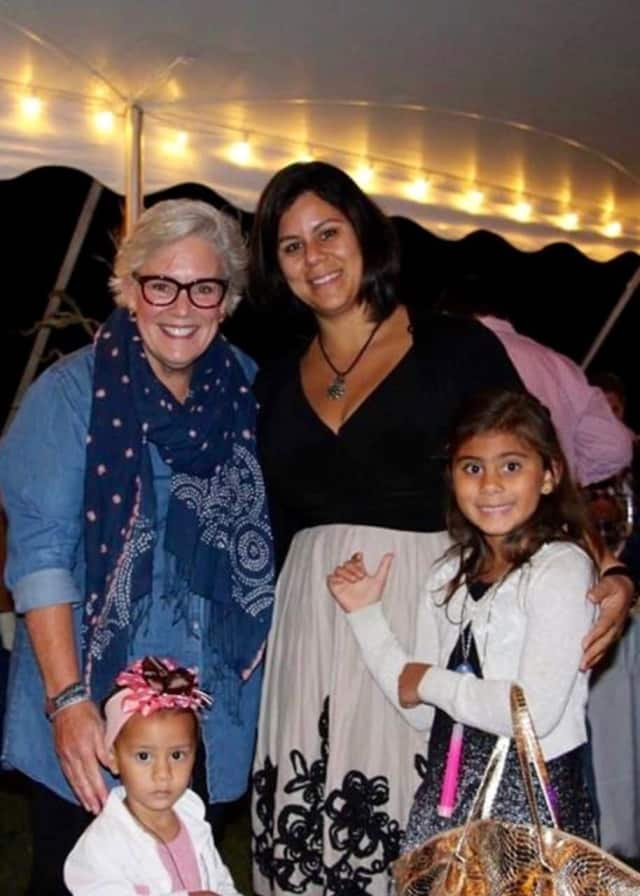 Laila Bravo celebrates at the BigGER RIG GIG with her daughters and Ceci Maher, executive director of Person-to- Person.