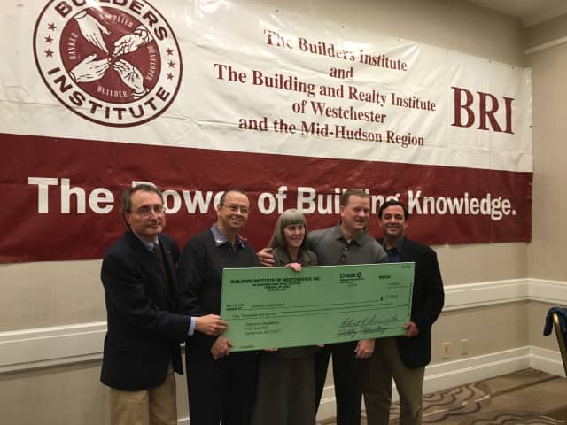 Presenting the donation to Operation Backbone are, from left, Building and Realty Institute Executive Director Albert Annunciate, BRI board members Angelo Ponzi and Jane Curtis, Mike Storm, Operation Backbone CEO, and BRI President Eric Abraham.