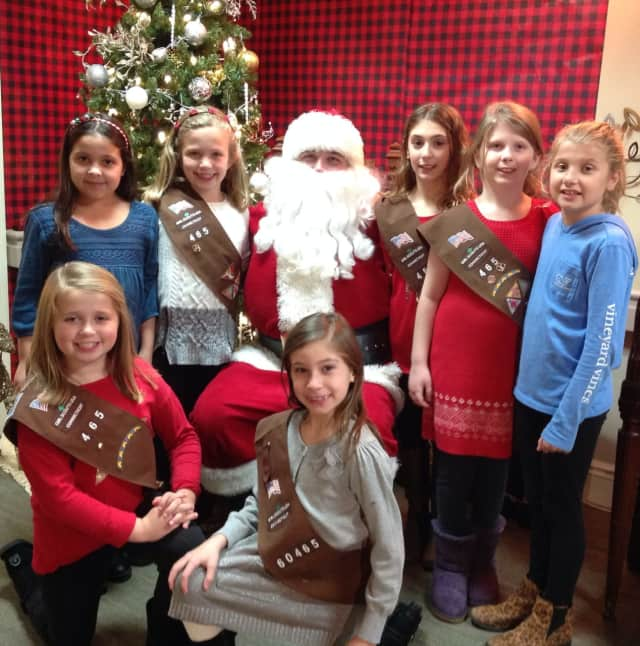 Shelton's Brownie Girl Scout Troop #60465 visits residents at Bishop Wicke Health and Rehabilitation Center.