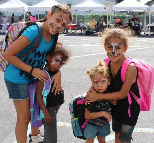 Yonkers students receive backpacks and school supplies at a recent back-to-school barbecue for kids, parents and guardians in Leake & Watts' Family Preventive Services programs in the Bronx.