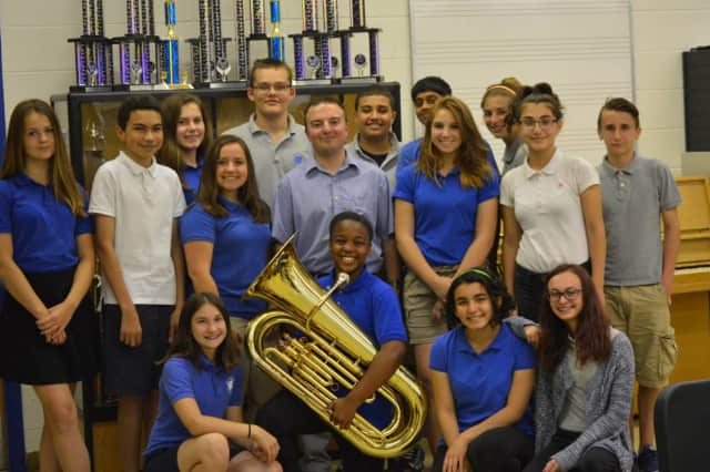 Music students are shown with Don Lopuzzo who has been chosen as Best Educational Professional of the Month by Wallington Public Schools.