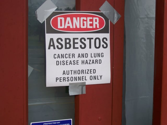 Asbestos warning sign photo illustration