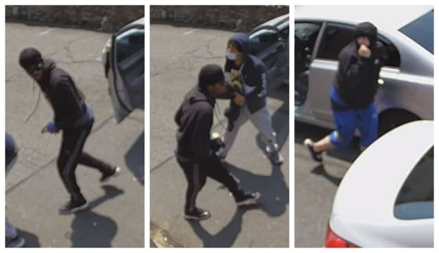Know them? Police are searching for three men who allegedly robbed a man sitting in his vehicle in broad daylight.