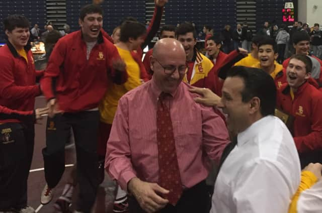 Bergen Catholic wrestling coach Dave Bell and assistant Dominick Spataro celebrate as the Crusaders won their fifth straight Non-Public A title.