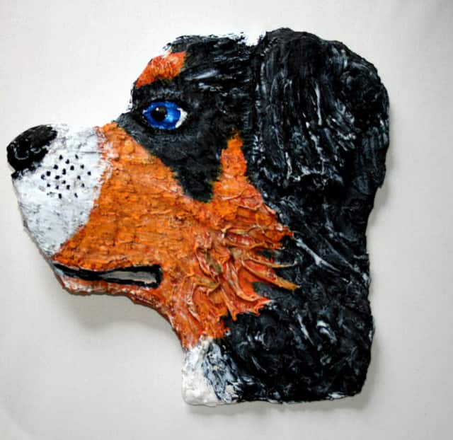 """One of the interactive mix-and-match sculpture pieces by artist Honorah O'Neill, titled """"Bernese Mountain Dog Head."""""""