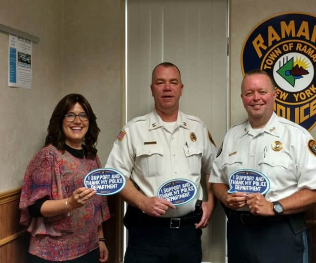 Monsey resident Shoshana Bernstein, left, holds one of the magnets she conceived to show appreciation for police. With her are Ramapo Police Chief Brad Wiedel, right; and Capt. Martin Reilly.