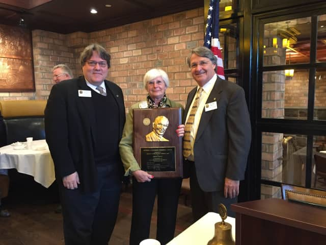 Betty Wiest receives the Arthur Fenniman Award from Rotary District 7490 Governor Peter Wells and District Governor Nominee/District Secretary James Boyer.
