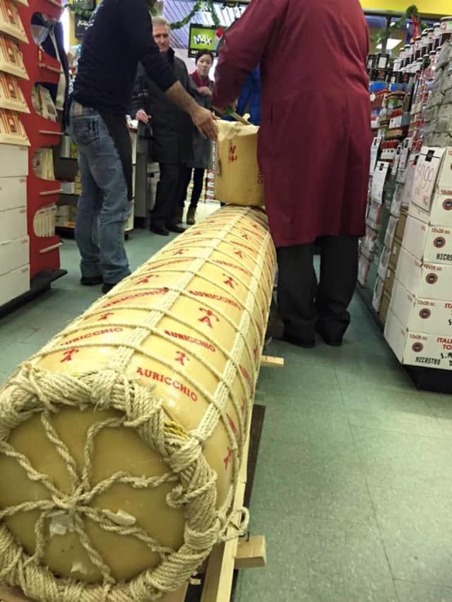 The 1,000-pound block Auricchio provolone arrives at La Bottega Nicastro in Ottawa. A Wilton man drove seven hours to Ottawa to see it.