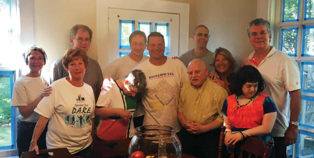 Executives from Bigelow Tea helped spruce up a Kennedy Center group home recently.