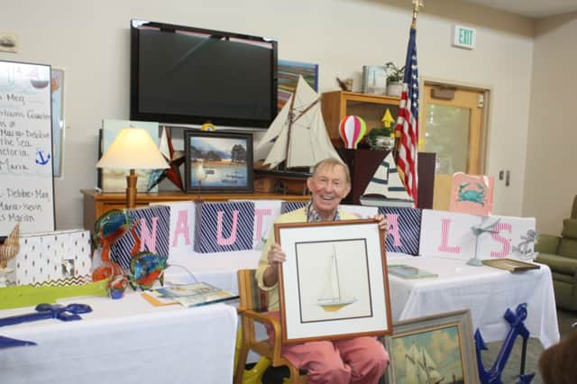 Bill Gray proudly presenting his nautical-themed program to Adult Day Program participants at Waveny LifeCare Network.