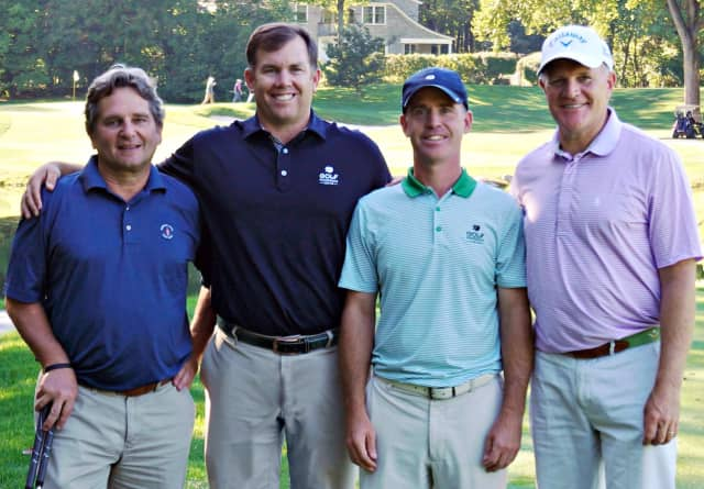 Rob Blosio of New Canaan, Roger Knick of Ridgefield, Dennis Hillman of Greenwich and Stepping Stones Museum for Children Board Member John S. Foster of Wilton are all smiles on the course at the Museum's Swing Into It! Golf Tournament.