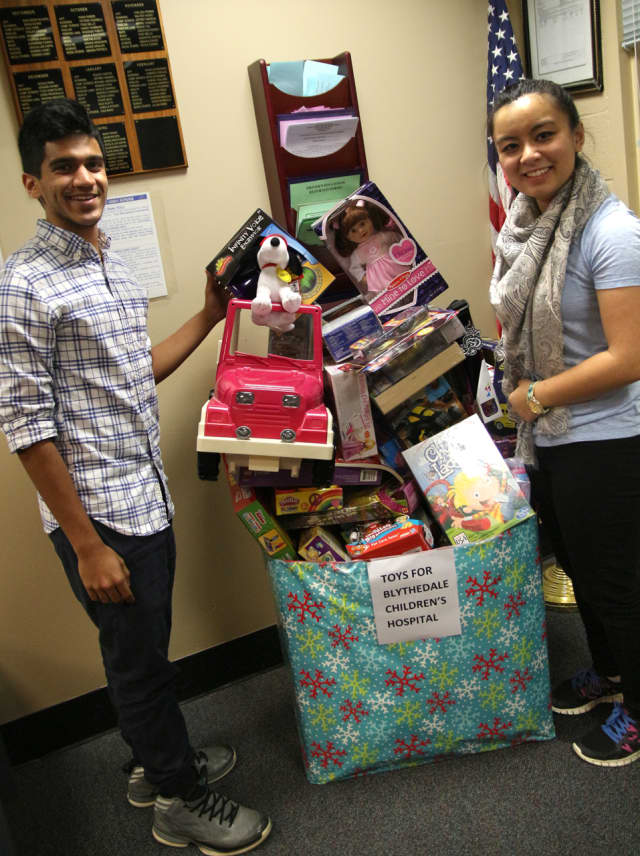 George Ittan and Noelle Santos of Westlake High School's National Honor Society help collect and distribute toys and other gifts for young patients at the Blythedale Children's Hospital in Valhalla.