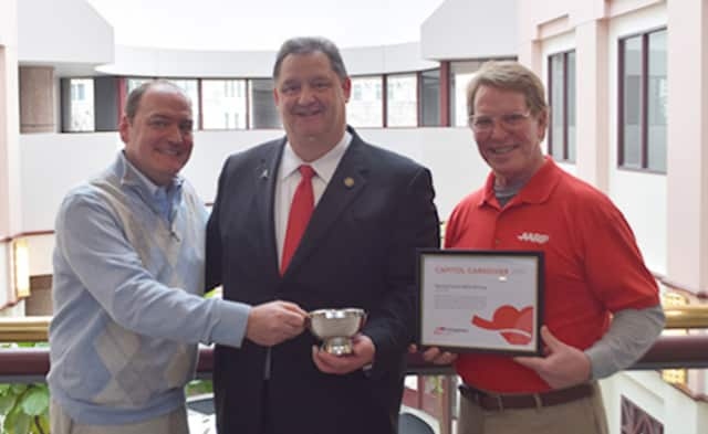 Representative Bolinsky (center) is presented with two awards from AARP by John Erlingheuser (L), AARP Connecticut Advocacy Director, and AARP volunteer Joseph Bennett (R).