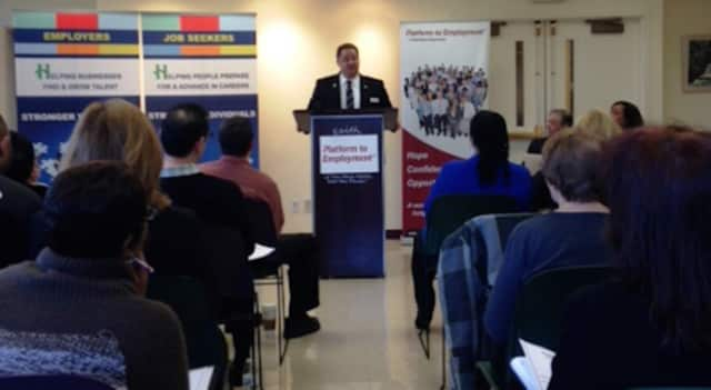 State Rep. Mitch. Bolinsky addresses the new participants of the Platform to Employment program at its kickoff event.