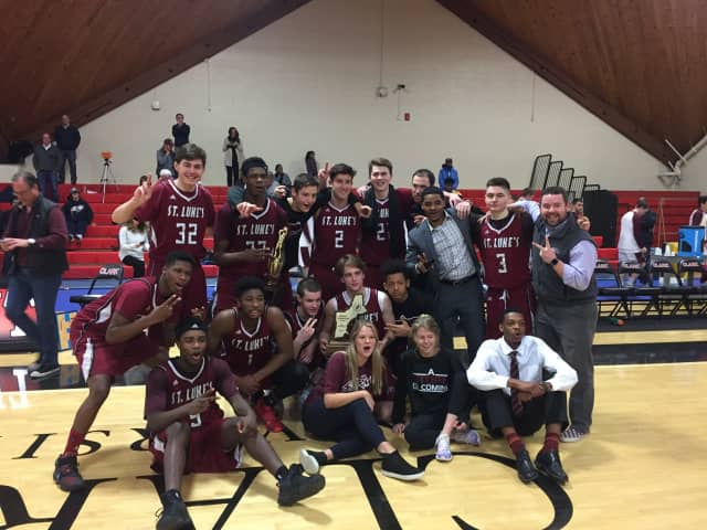The Boys Varsity Basketball team at St. Luke's in New Canaan wins the New England Preparatory School Athletic Council championship.