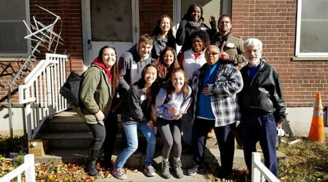 Sacred Heart University students and their professor assemble for a walking tour of Bridgeport's South End neighborhood.