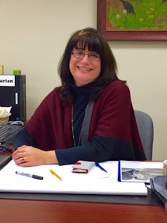 Brenda McKinley, Library Director of the Cyrenius H. Booth Library.