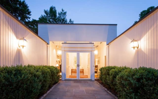 The entrance to 123 Marlborough Road in Briarcliff Manor, now on the market through Houlihan Lawrence for more than $1.7 million.