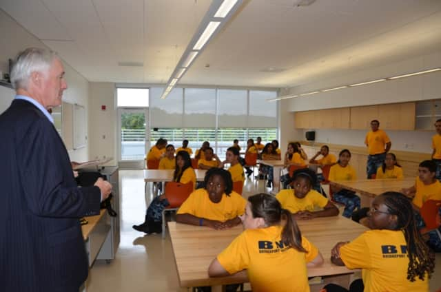 Former Bridgeport Mayor Bill Finch talks to students at the Bridgeport Military Academy. Thirty cadets from the high school recently participated in their first drill meet, winning a trophy for outstanding sportsmanship.