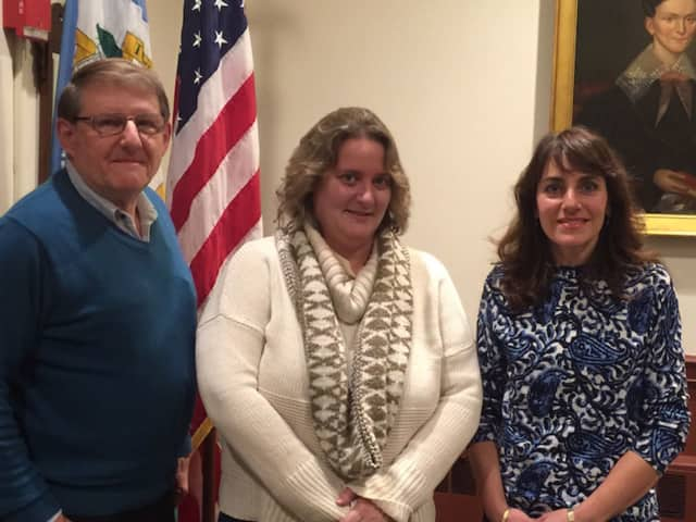 Brooke Valenti, center,a new member of the Weston Republican Town Committee, member, with board members Woody Bliss and Dawn Rivera.
