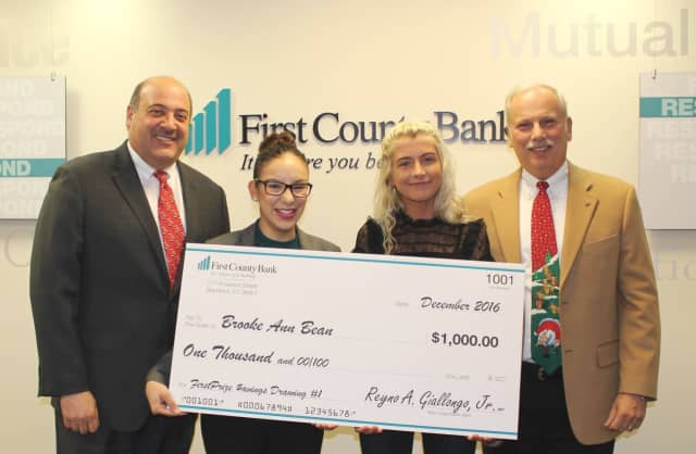 Robert Granata, COO and president of First County Bank; Aitza Cabrera, AVP and Darien branch manager of First County Bank; Brooke Anne Bean the FirstPrize Savings drawing winner; Reyno A. Giallongo, Jr., chairman and CEO of First County Bank.