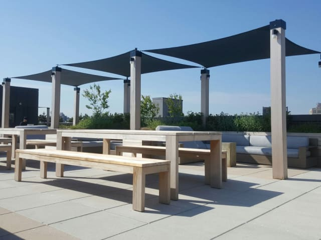 Shade sails provide elegant-looking sun protection on this rooftop in Brooklyn. Courtesy Gregory Sahagian & Son.