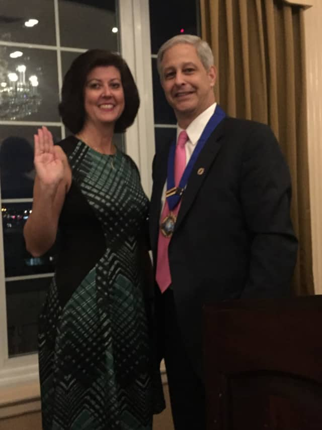 Fairfield Town Clerk Betsy Browne took her oath of office as president of the New England Association of City and Town Clerks from Vincent Buttiglieri, who is president of International Institute of Municipal Clerks.