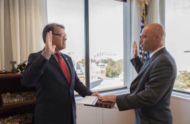 Bruce Walker gets sworn in by Rick Perry.