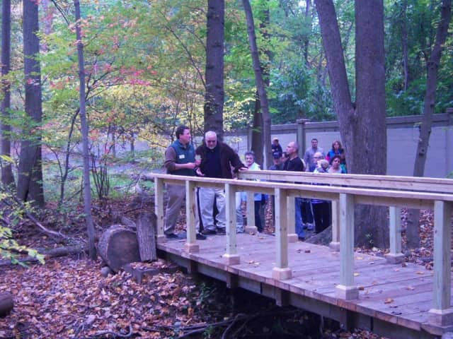 White Plains citizens walking a trail in Bryant-Mamaroneck Park.