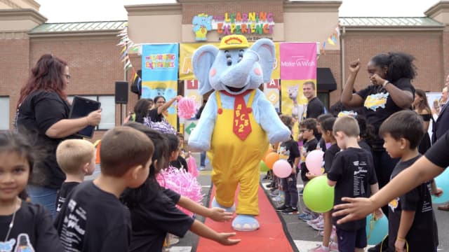 "Preschoolers at The Learning Experience in Dobbs Ferry meet fun-loving elephant ""Bubbles"" to raise money for Make-A-Wish. It is part of a philanthropy curriculum which teaches and shows children how to practice kindness."