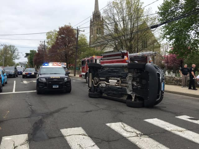 A Jeep rolled over near the intersection of Westport Avenue and East Avenue near St. Paul's on the Green on Monday afternoon in Norwalk.