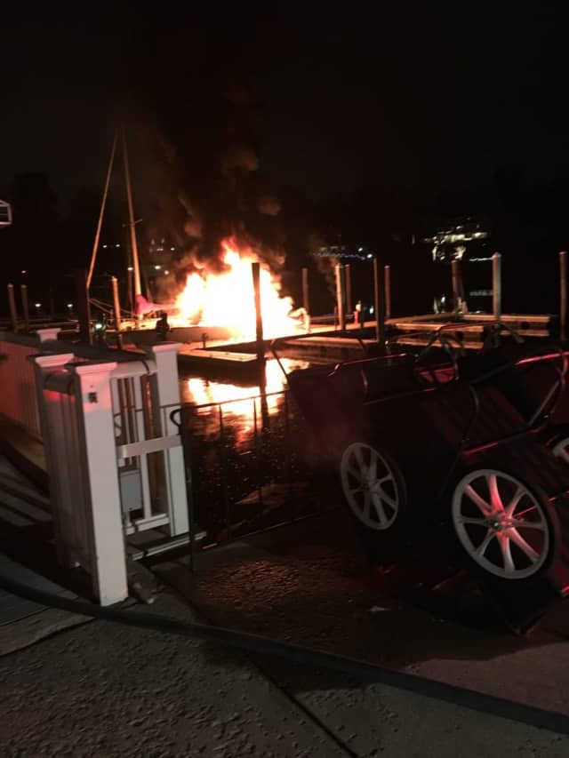 A boat is consumed by flames late Friday at the Greenwich Boat and Yacht Club on Grass Island Road in Greenwich.