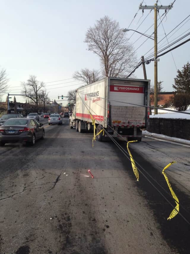 Maple Avenue closed in Greenwich after a truck pulled down wires on Monday morning.