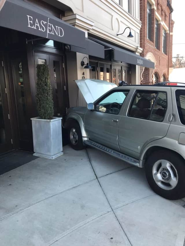 A car is up on the sidewalk on 400 Greenwich Ave. in Greenwich.