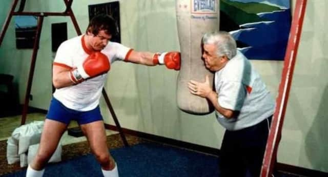 Lou Duva, right, working with one of the many championship boxers he trained.