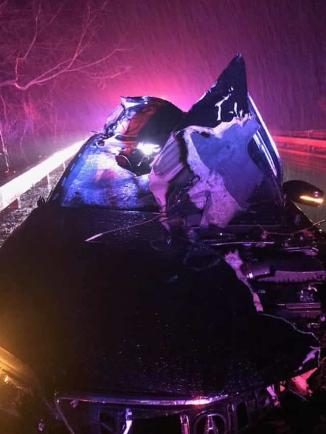 A tree slammed into a car overnight on the Merritt between exits 31 and 33 in Greenwich.