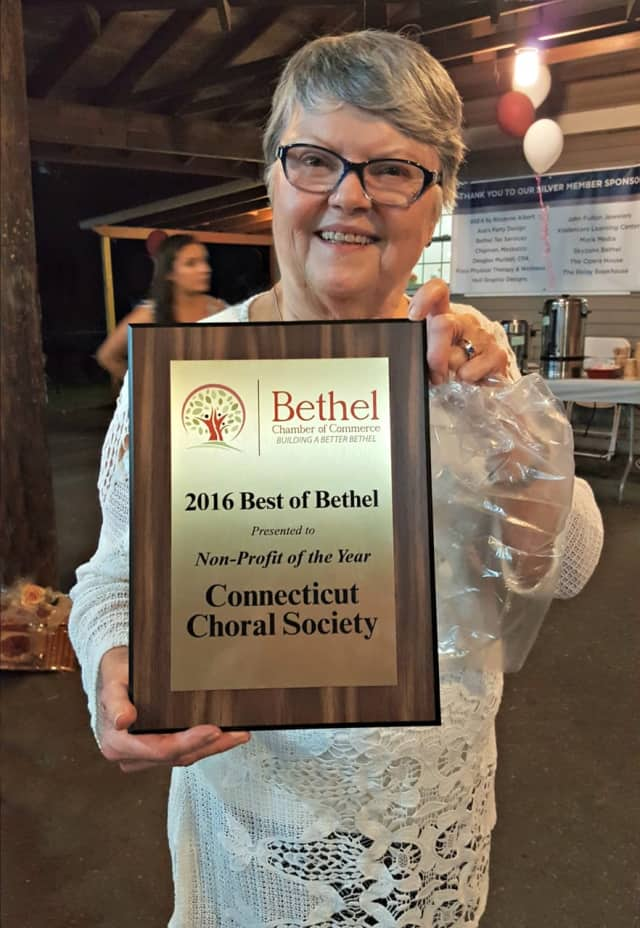 Connecticut Choral Society President Jill Heidel shows off the award for Nonprofit of the Year.