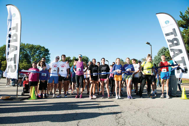 Runners assemble at the starting line before the annual walk/run in Paramus, in 2012.