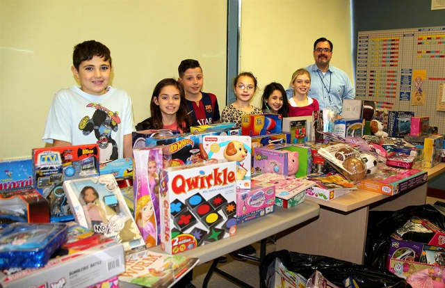 Students, their families and school staff from Columbus Elementary School in Thornwood held a toy drive this month.