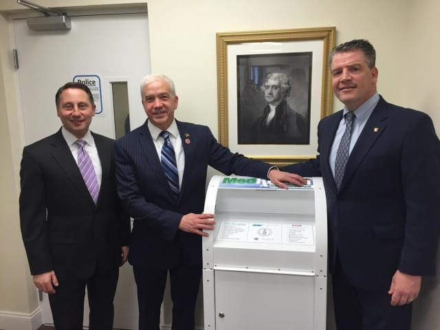 From left, Westchester County Executive Rob Astorino, Westchester County Legislator Francis Corcoran and state Sen. Terrence Murphy pose with a drug drop-off box in North Salem.