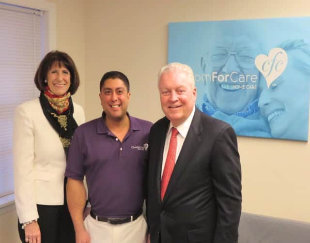 Fairfield Chamber of Commerce President Beverly Balaz, left, and First Selectman Mike Tetreau, right, were on hand at the opening of Neil Anand's ComForCare office in  Fairfield.
