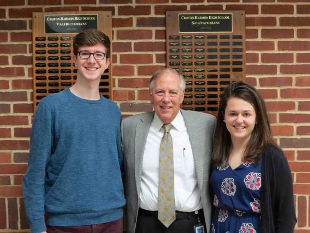 Croton-Harmon 2016 valedictorian Duncan McManus and salutatorian Susan Rykowski stand with their principal Alan Capasso.