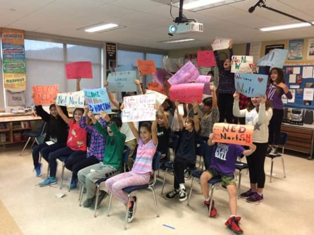 """Fifth-graders at the Seven Bridges Middle School in Chappaqua hold up signs of encouragement while Skyping with Ned Norton, one of the everyday heroes featured on CNN's 10th anniversary special, """"CNN Heroes: An All-Star Tribute."""""""