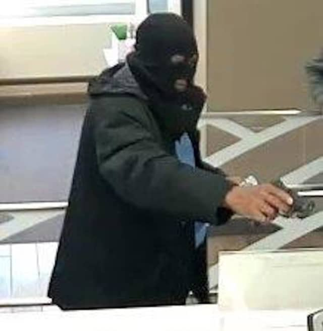 Police in Nassau County released a photo of an armed robber who took a gun into a Bank of America location in Great Neck.