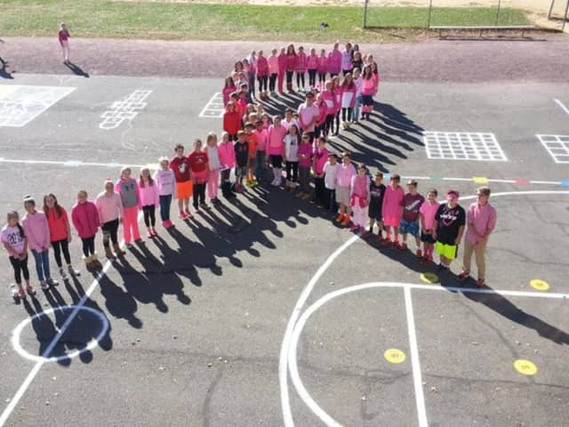 Ho-Ho-Kus students formed a human pink ribbon for breast cancer awareness month.