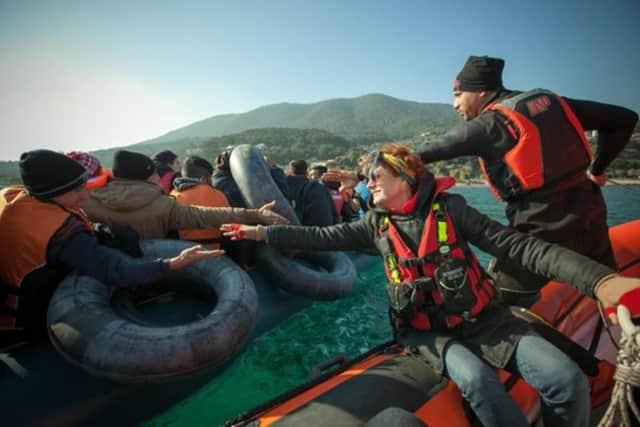Susan Sarandon traveled to Greece to greet Syrian refugees.