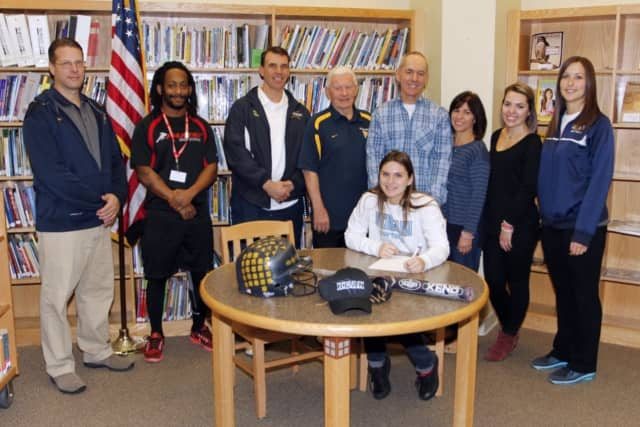 Saddle Brook High School senior Taryn DiGiacomo, seated, signs her letter of intent to play softball at Kean University.