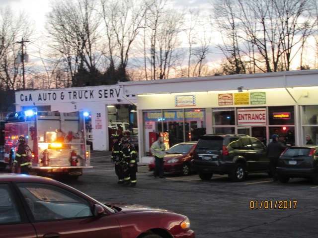 Emergency responders at C & A Auto Service on Route 6.