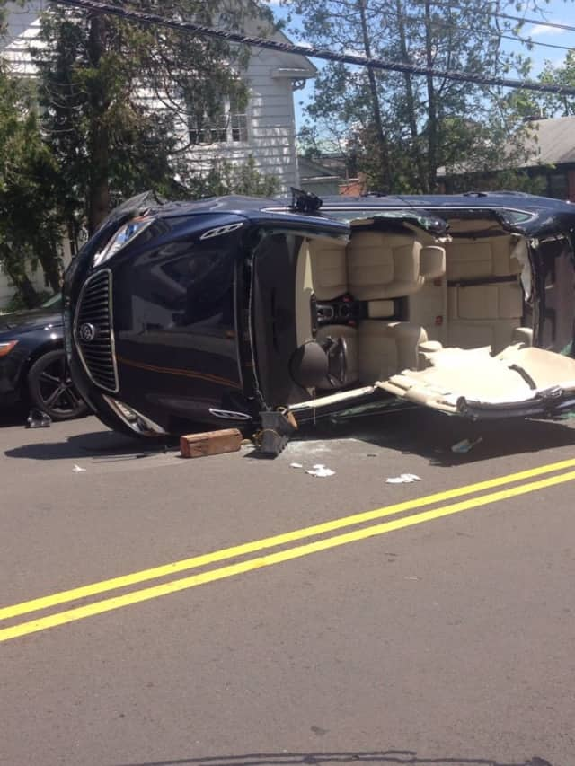 An elderly woman was injured in a rollover crash in Greenwich on Sunday.