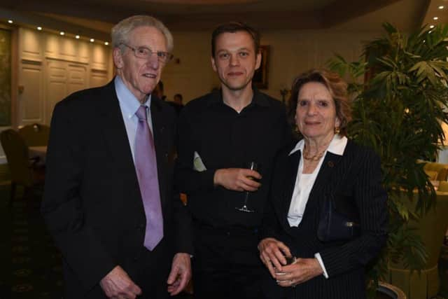 Award recipient Radek Dobrowolski, left, stands with Jane and Andy Cahn at the reception.